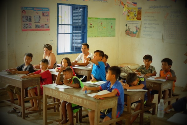 Image shows the Shine students interacting with the teacher in class